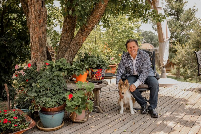 André García-Nuthmann at home with his pup.
