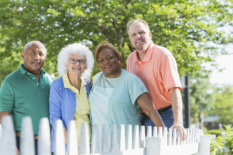 Multiracial group of seniors standing outdoors