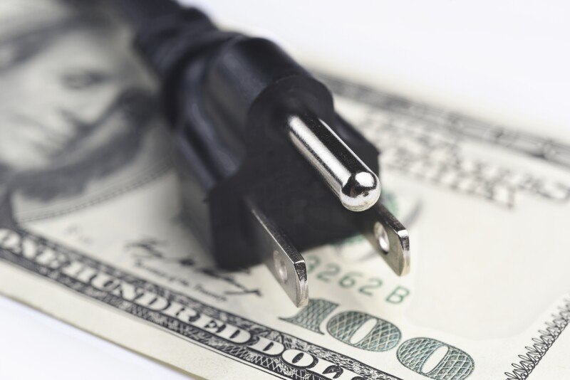 power cord over us dollar bills