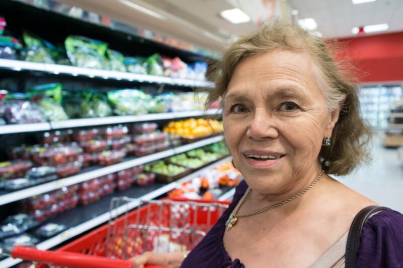 senior woman groceries hispanic