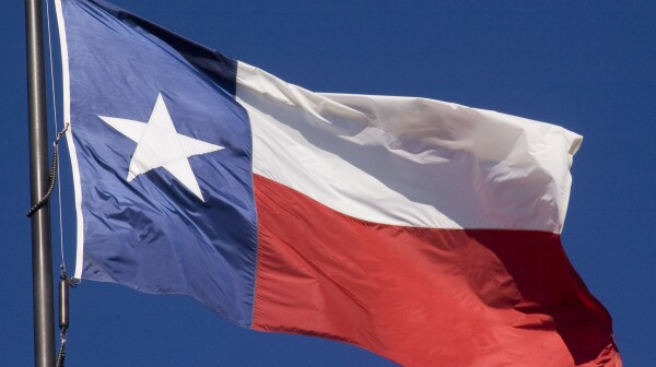 The state of Texas lone star flag flying proudly in the air