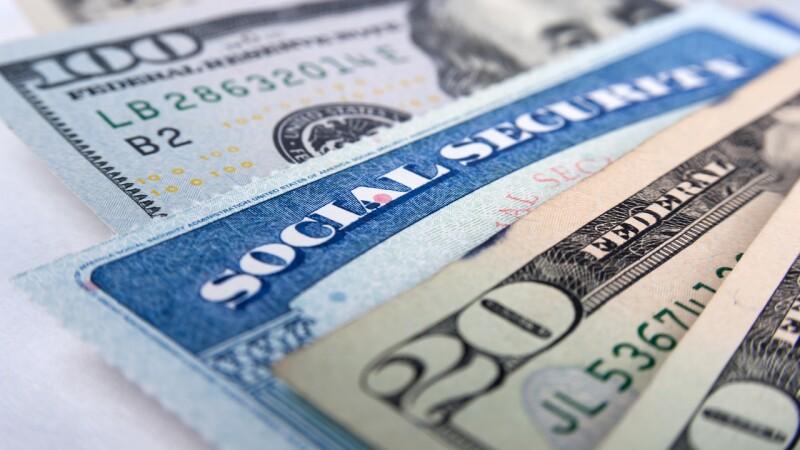 Social security card and American money dollar bills