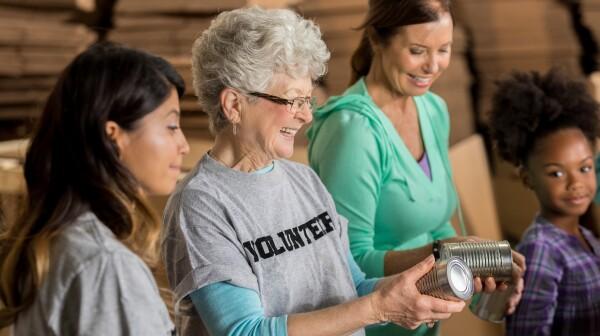 Team of diverse food bank volunteers receive donations
