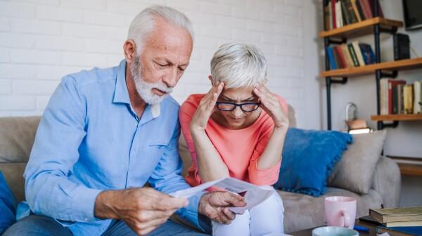 Senior couple having problems with home finances