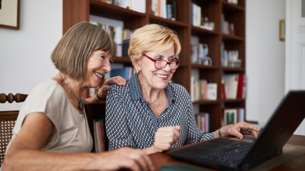 Senior friends doing shopping online