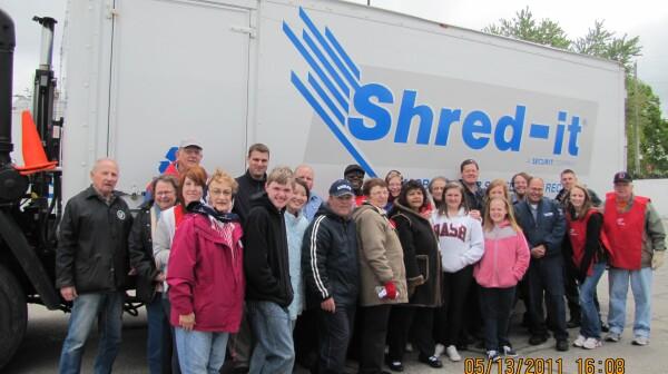 AARP Volunteer team and Shred-It staff