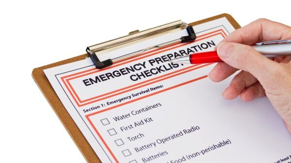 Hand completing Emergency Preparation List