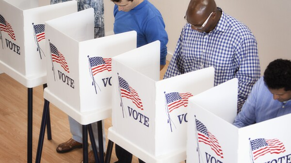 Voters voting in polling place