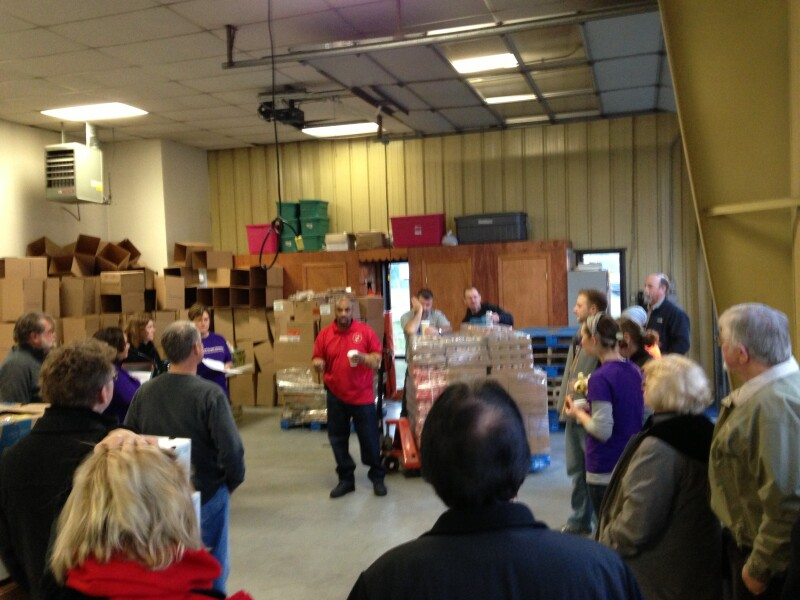 Workers prepare food boxes for Sandy-affected residents in Crisfield, MD.