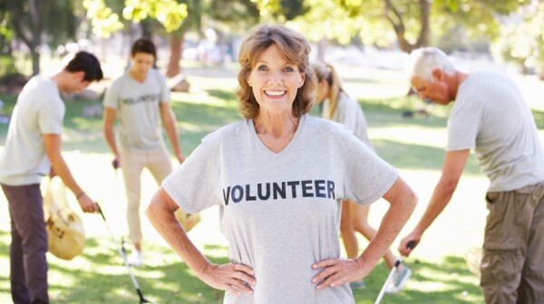 Volunteer Group Clearing Litter In Park