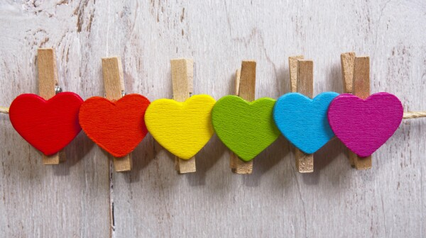 heart multicolored on a white wooden background.LGBT symbol