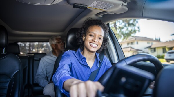 Young Black Woman Driving Car for Rideshare