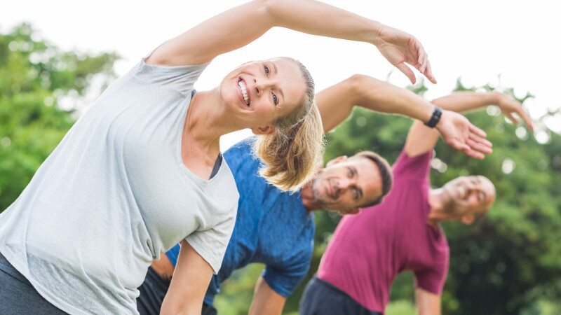 People doing stretching exercise
