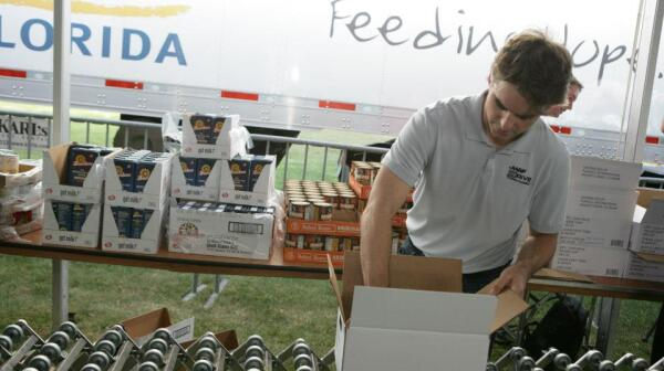 Jeff Gordon packing food box Feb 2013