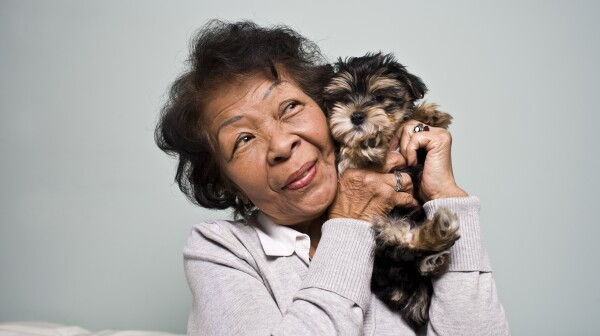 Senior Woman holding a Puppy