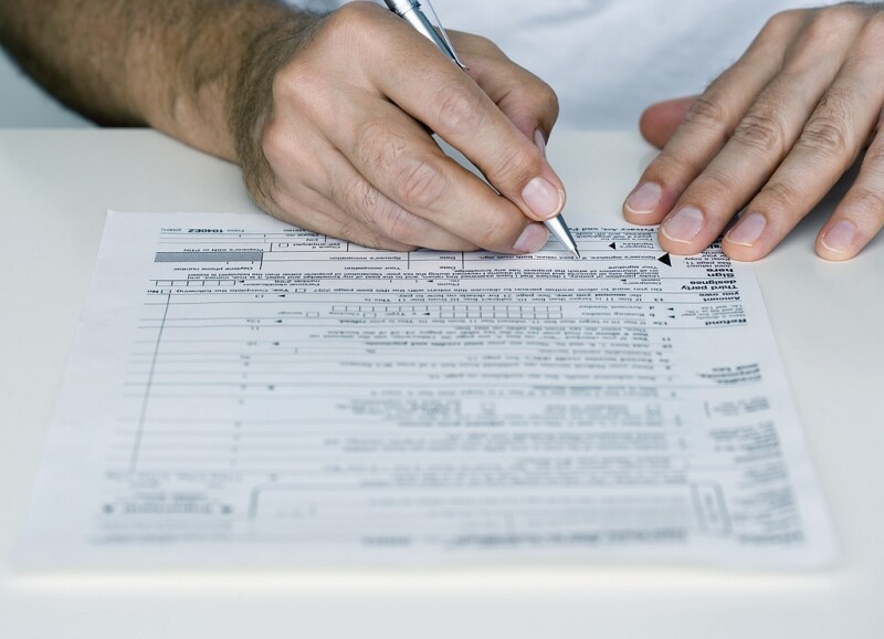 Man Filling out Form