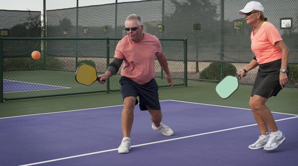Mixed Doubles Pickleball Action - Smooth Backhand