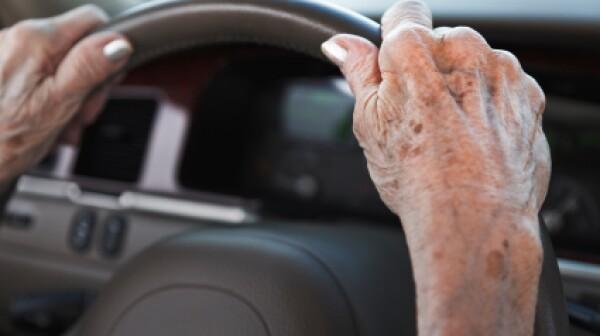 senior woman driving car