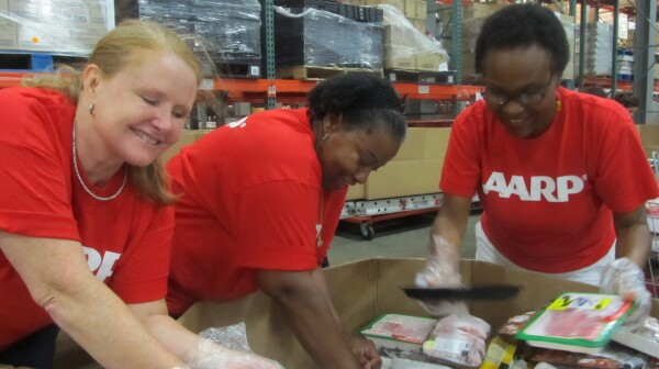 AARP volunteers food bank - showing diversity close-up