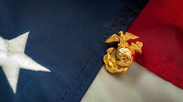 US Marine Corps emblem on the American flag