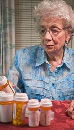 senior woman and prescription medication