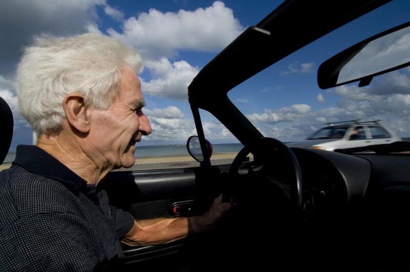 Senior in a convertible