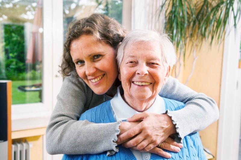 mature woman embracing senior woman