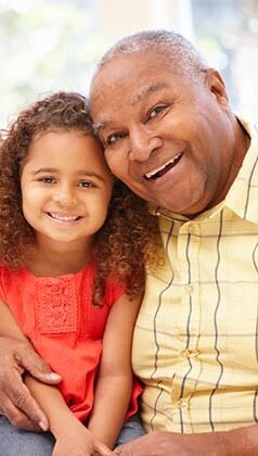 Senior African American man and granddaughter