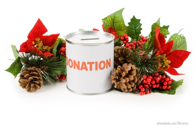 Donation can with Christmas poinsettia bouquet on white