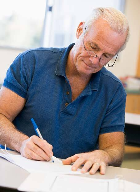 620-man-writing-student