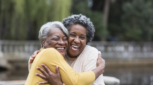 Senior black women embracing