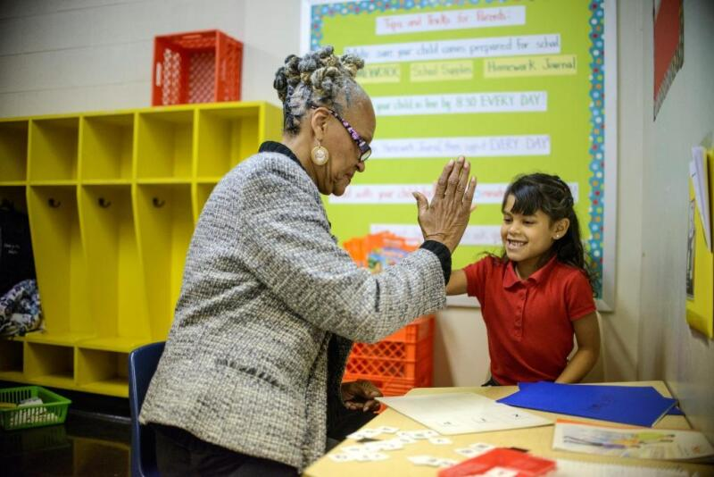 Philadelphia, Pennsylvania - October 24, 2013:Harmony, a first grader in Delilah Montemayor's class is tutored by AARP Experience Corps volunteer Margaret Plenty at Cramp Elementary School.