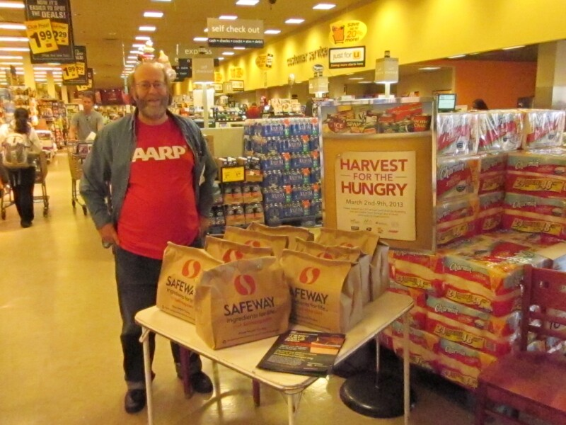 AARP Maryland volunteer Ed Yalow donates his time to encourage others to donate food for Harvest for the Hungry in Baltimore.