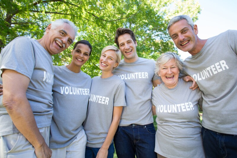 Happy volunteer family smiling at the camera