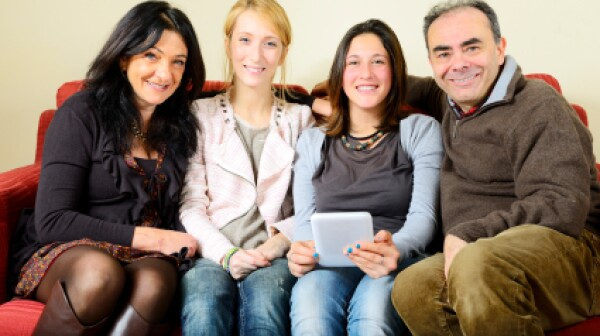 iStock_family with iPad Lisa-Blue