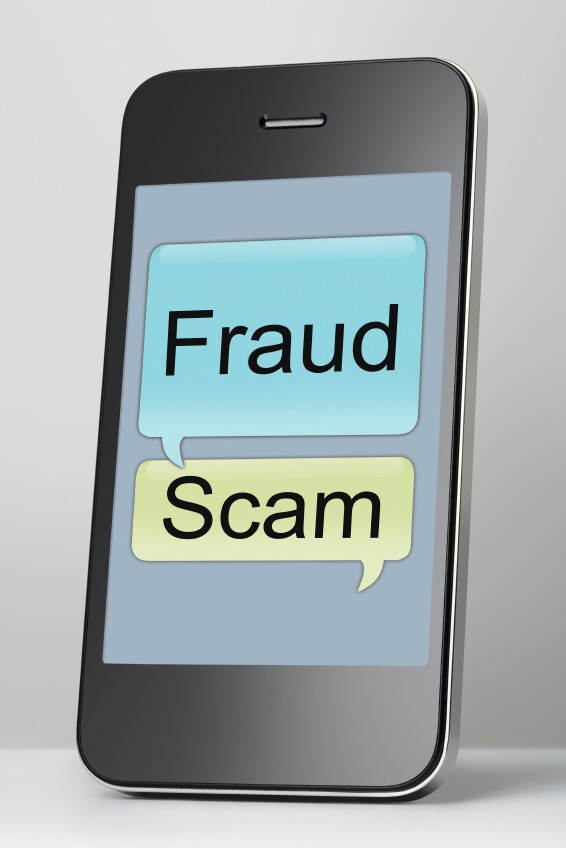 Mobile phone with scam and fraud message speech bubble