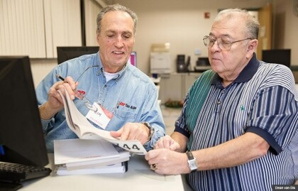 Jim Gonzales, left, an AARP Foundation Tax-Aide volunteer, recommended the free tax-preparation service to Ray Jimenez, of Taylor