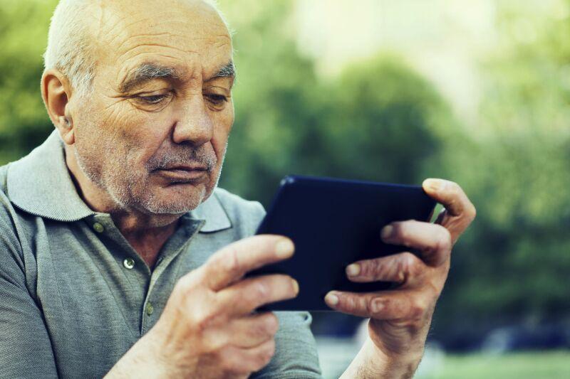 senior man surfing the net.jpg