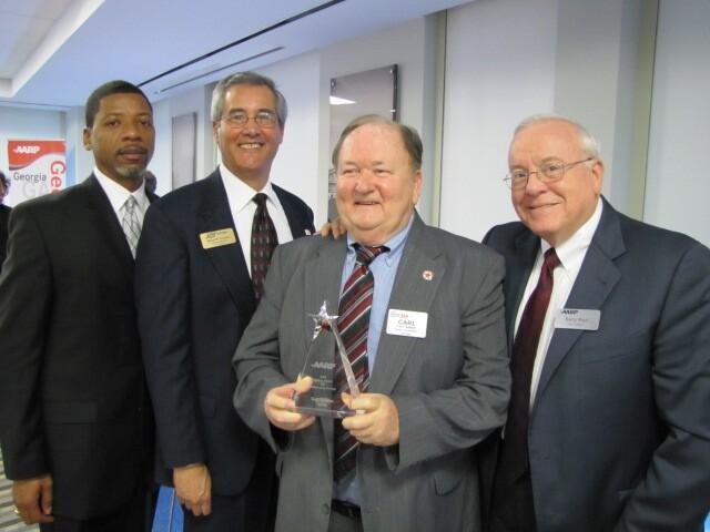 Carl Dasher accepts Andrus Award