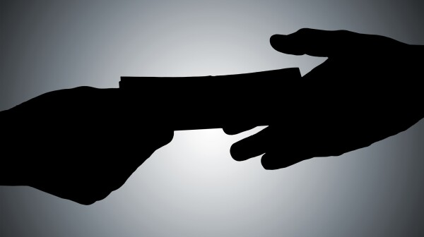 Silhouette Of Hands Giving Bribe