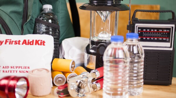 Emergency preparedness natural disaster supplies. Water, flashlight, lantern, batteries.