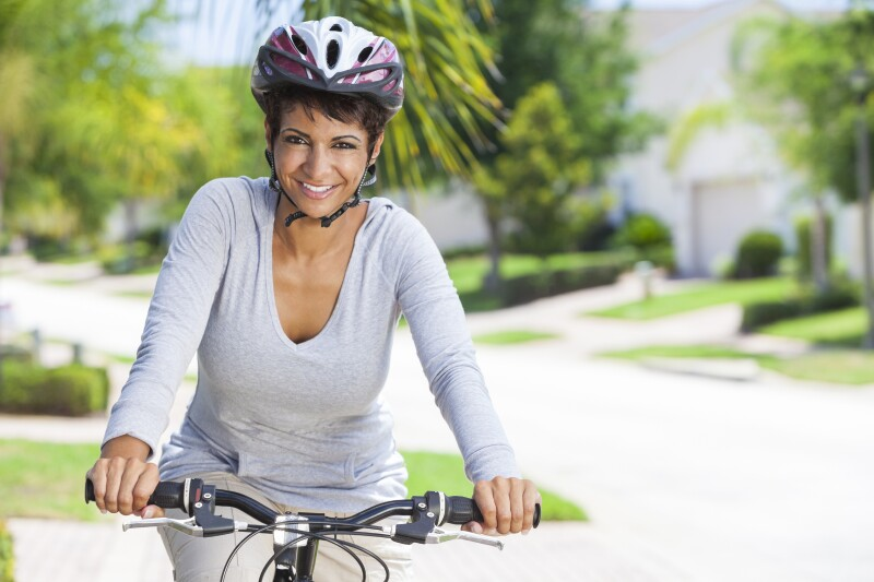 African American Woman Riding Bike