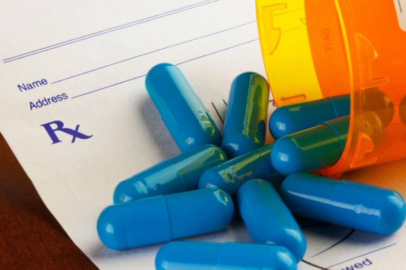 Blue Capsules on a Prescription Form