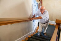 Elderly man climbing stairs_ Kali Nine LLC_sized for ET