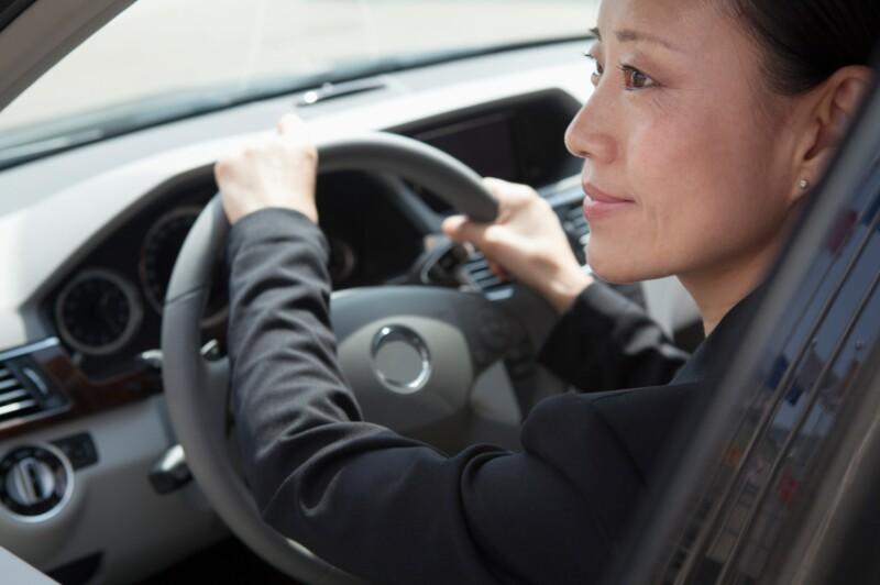 iStock_asian woman driving XiXinXing