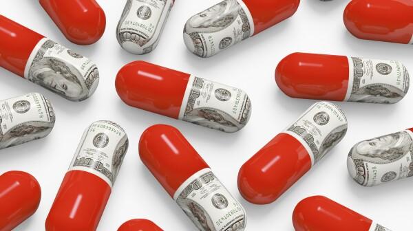 Pills decorated with dollar bills