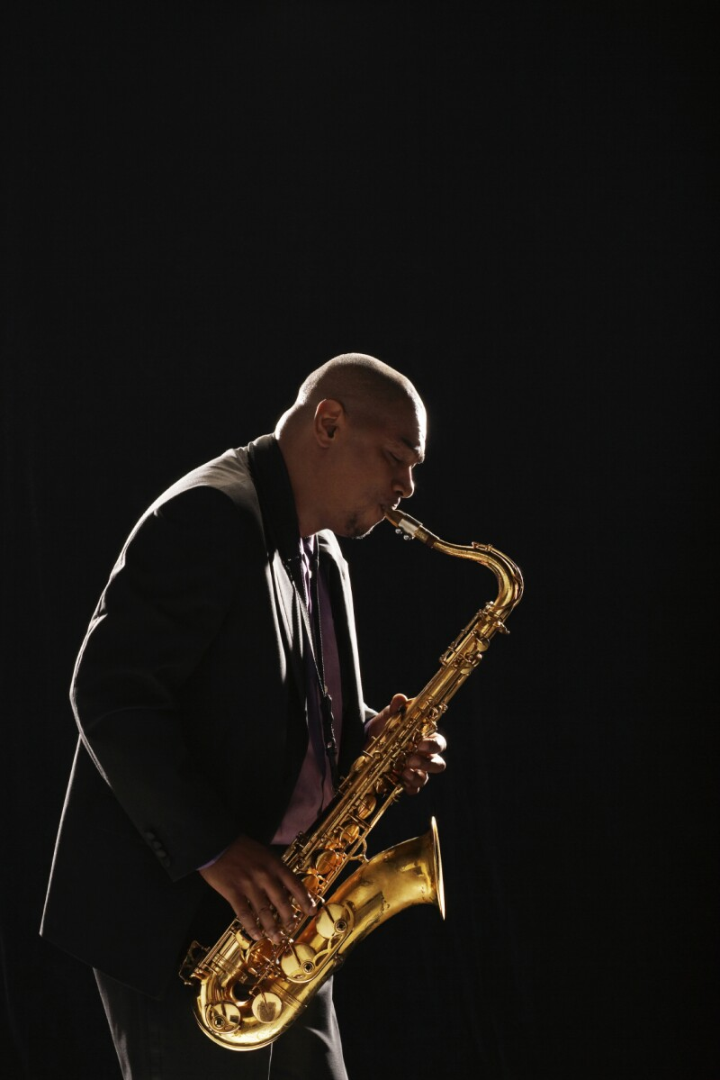 Side View Of Man Playing Saxophone