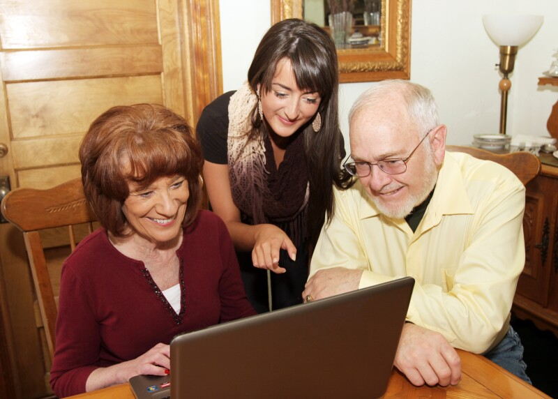 two women and man at laptop
