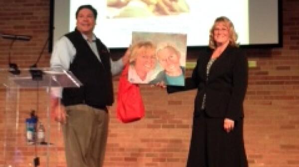 Nancy Madsen-Wilkerson receiving painting