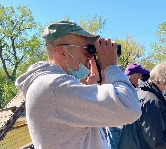 Dennis leads a group bird watching